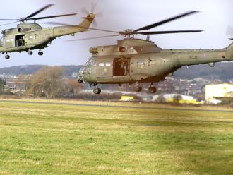Puma HC1s, XW229 and XW237, leaving The Helicopter Museum