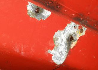 Corroded under-fuselage fairings.