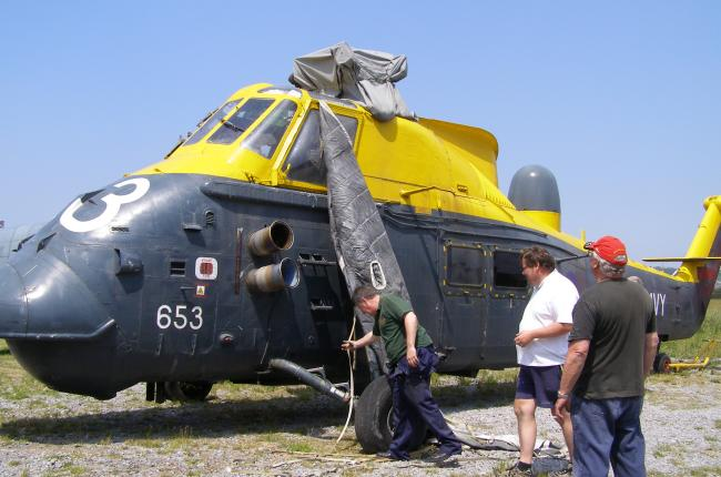 Westland Wessex HAS.3, XM328, being prepared for the move, from open air storage, into the Main Display Hangar